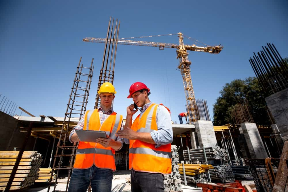 Workers and crane in construction industry